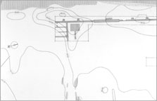 Plan of a section of the enclosure wall, showing the pylon base on the east side and the isolated set of garden plots