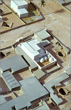 Detail of the model of the housing area of the Main City at Amarna. Note the circular granaries with domed tops, the upper floors of the house, and the wells