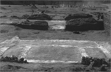 Excavation photograph of the gypsum foundations for a stone chapel belonging to house U24.1 in the North City, view to the west