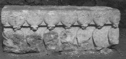Limestone block sculpted with a frieze of cobras, from the gateway of the North Riverside Palace