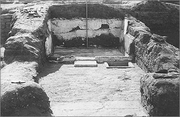 Excavation photograph of 1923, viewed to the south, showing the bathroom, with limestone floor, sandstone tank, and gypsum covering of the walls
