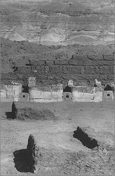 Excavation photograph of 1923 showing the limestone mangers depicting cattle, view to the north