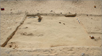 Figure 18. Grid Square K52 showing spread of burial pits. View site south