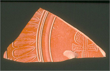 An African Red-slip Ware sherd from the monastery at Kom el-Nana, decorated with the Christian Chi-rho symbol.