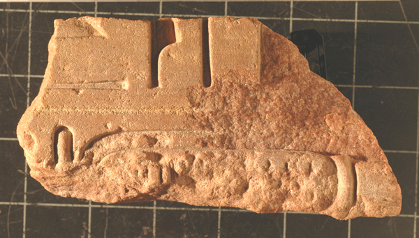 Figure 3. A piece of statue base that has been chipped away after the cartouche was already erased (S-6657).